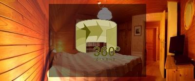Panorama: Wellness-Hütte Schlafzimmer mit Sauna